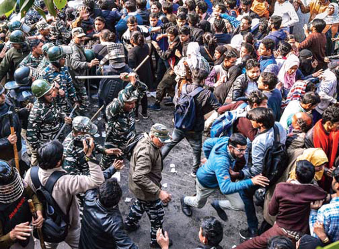 Police baton-charge protesters during their march against the amended Citizenship Act, NRC and NPR, near Jamia Nagar in New Delhi