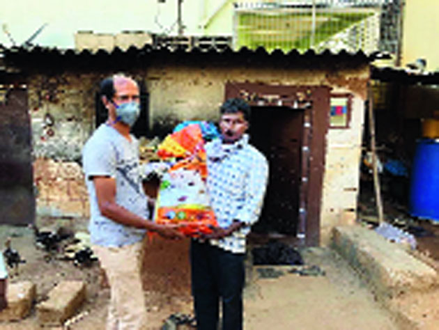Food packets being distributed in a village