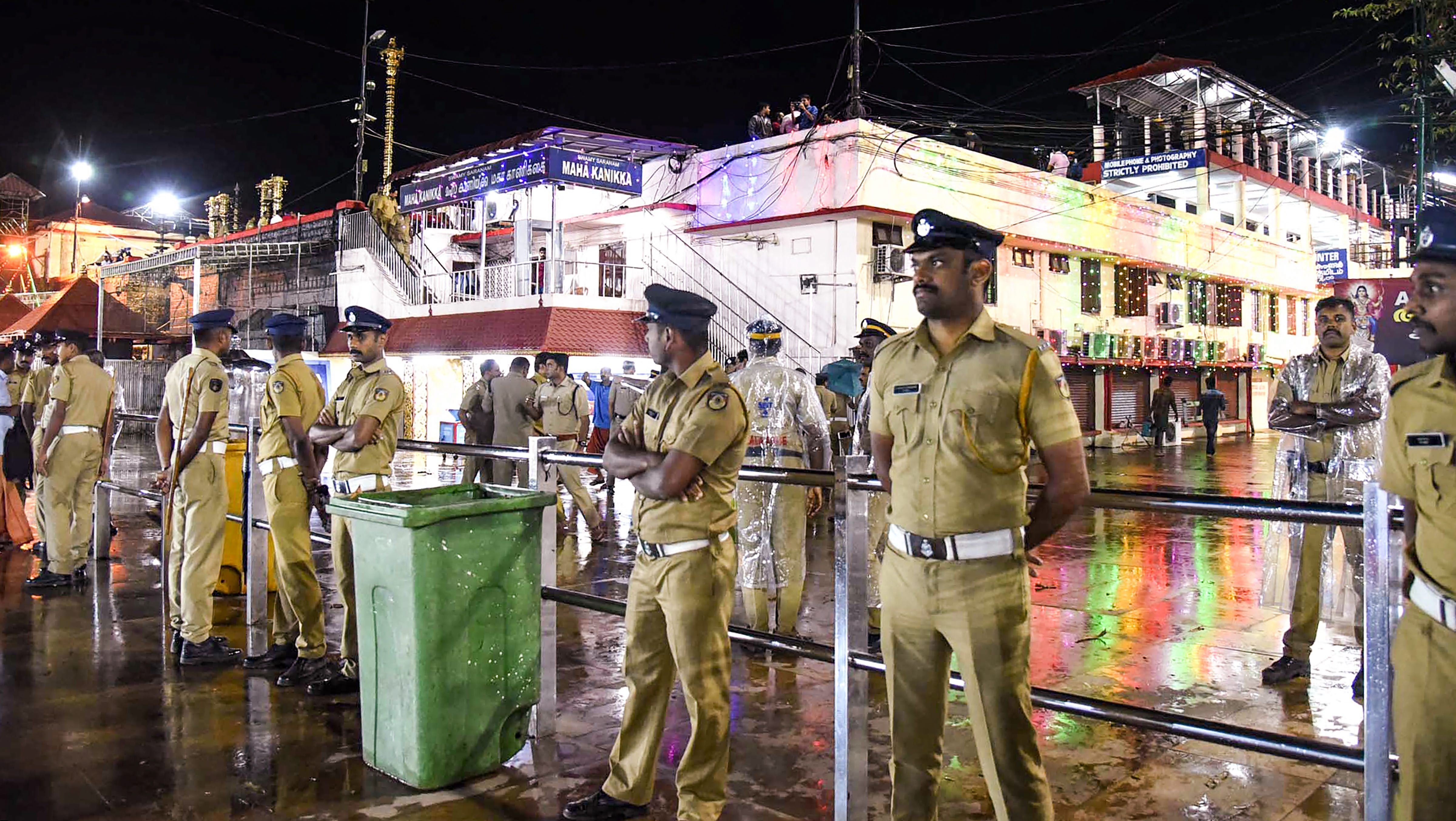 Policemen stand guard as the Sabarimala temple opens on Friday.