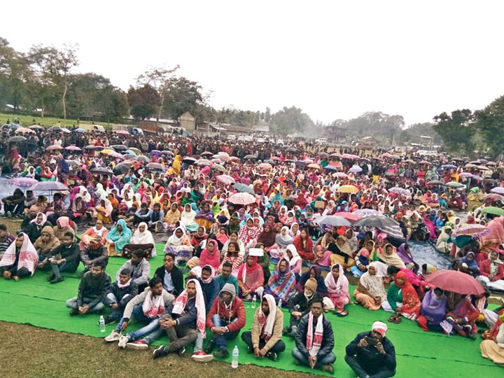 Tea workers at a rally against the Act in Tinsukia district on Sunday.