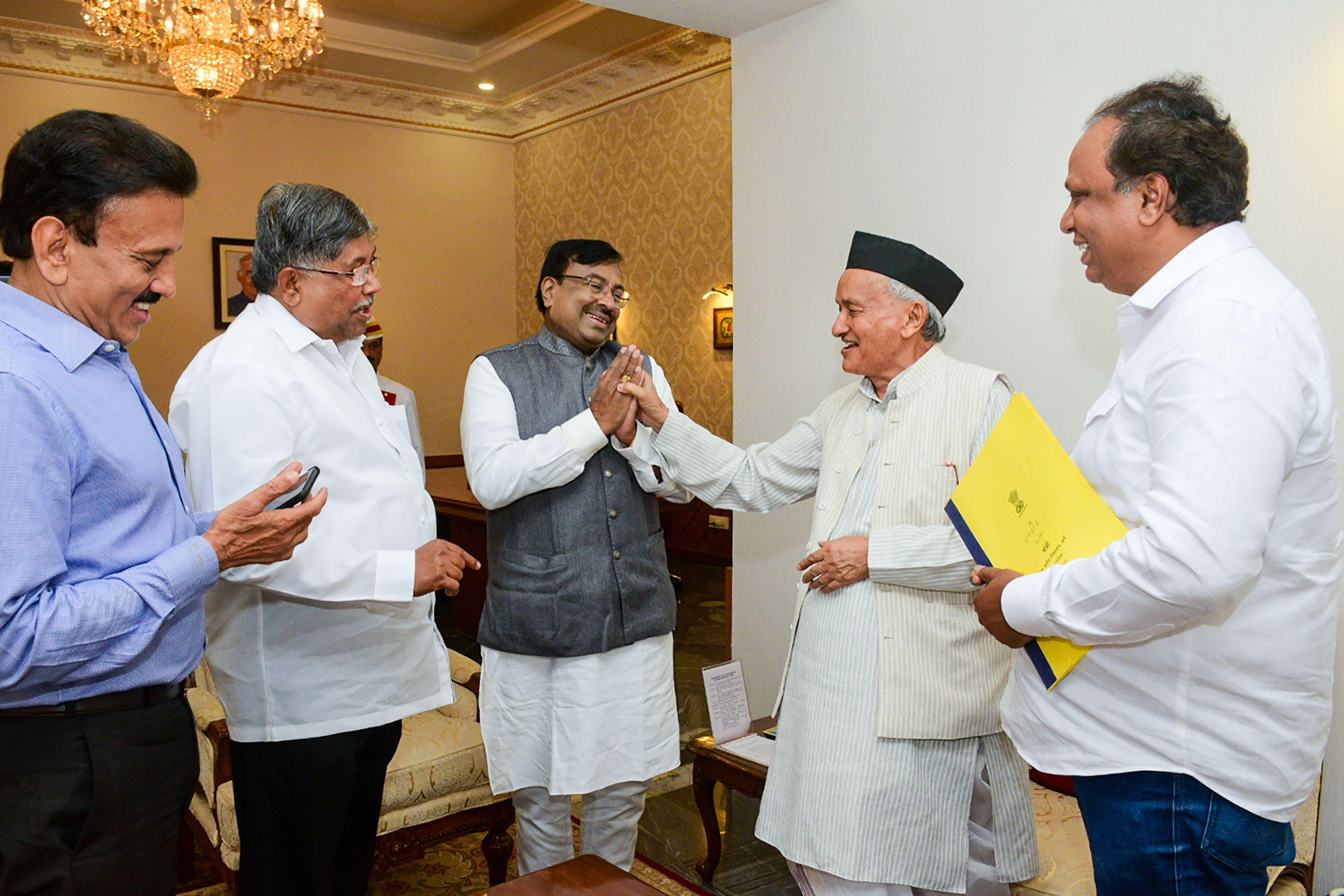In this November 7, 2019, photo, Maharashtra governor Bhagat Singh Koshyari meets with senior BJP leader Chandrakant Patil (2nd Left), Sudhir Mungantiwar (Centre) and others, at Raj Bhawan in Mumbai on Thursday.