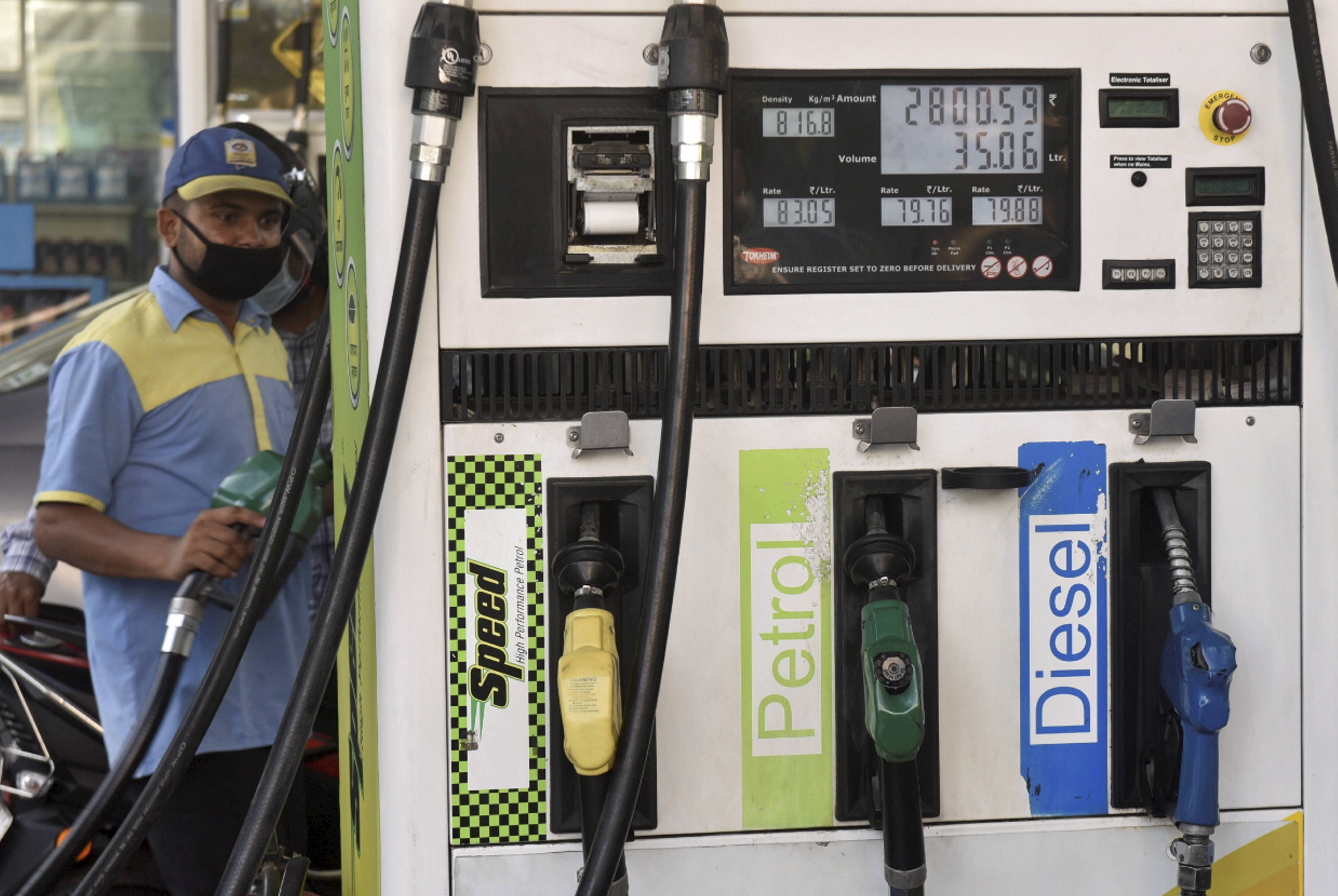 An employee works at a fuel station in New Delhi on June 24. Diesel will now cost more than petrol in the city after its price was hiked by 48 paise