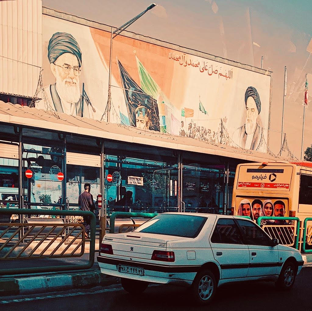 Portraits of Iranian Supreme Leader Ayatollah Ali Khamenei (L) and the late Ayatollah Ruhollah Khomeini (R), who in 1979 led an uprising that ousted the Shah of Iran, on a Tehran billboard