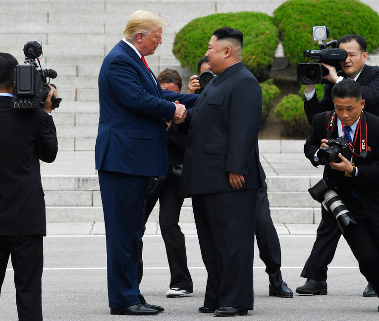 President Donald Trump walks to the North Korean side of the border with North Korean leader Kim Jong Un at the border village of Panmunjom in the Demilitarized Zone on Sunday, June 30, 2019.