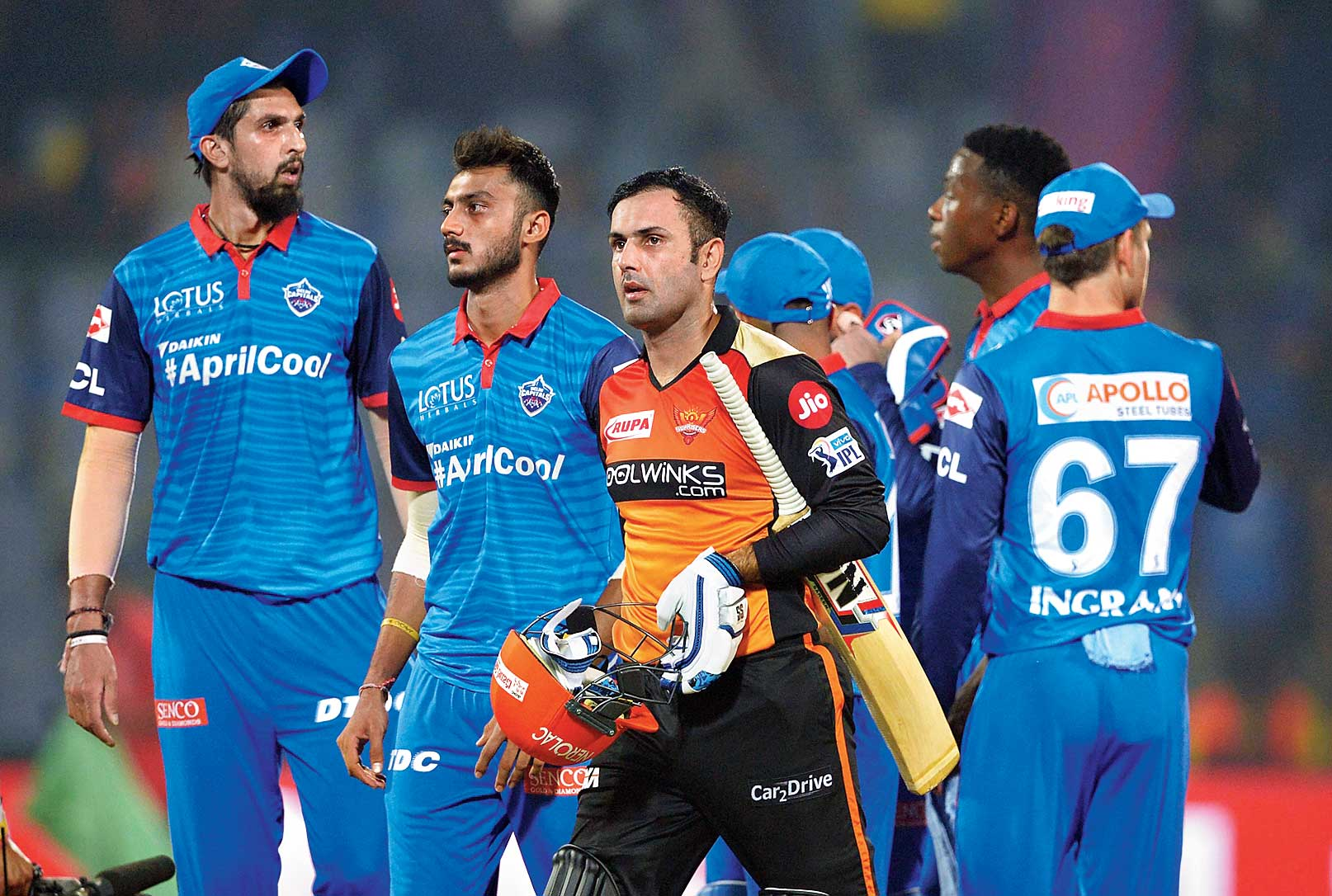 Sunrisers Hyderabad's Mohammad Nabi and dejected Delhi Capitals players at the Kotla on Thursday.