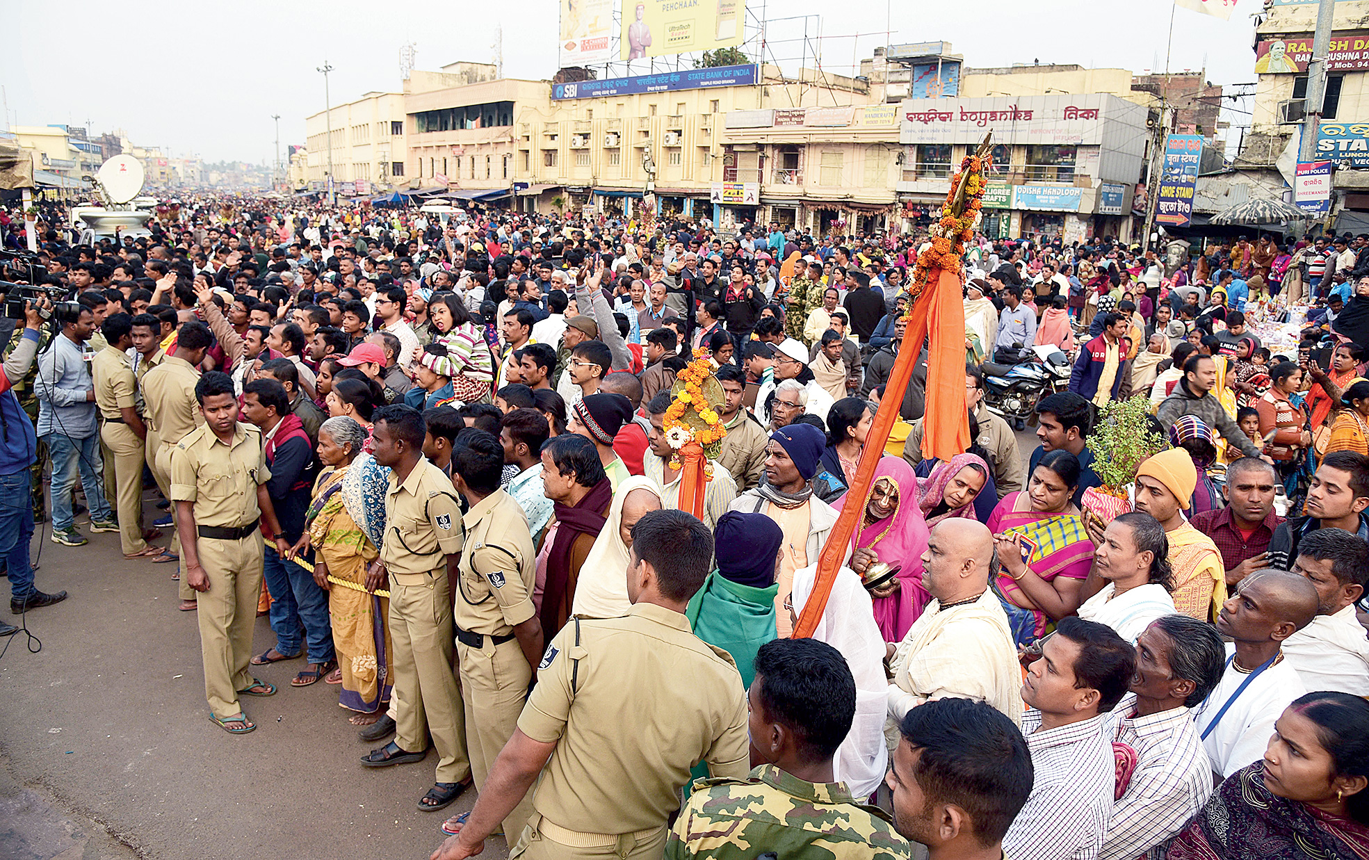 Police stop devotees at the Jagannath temple in Puri on Friday.
