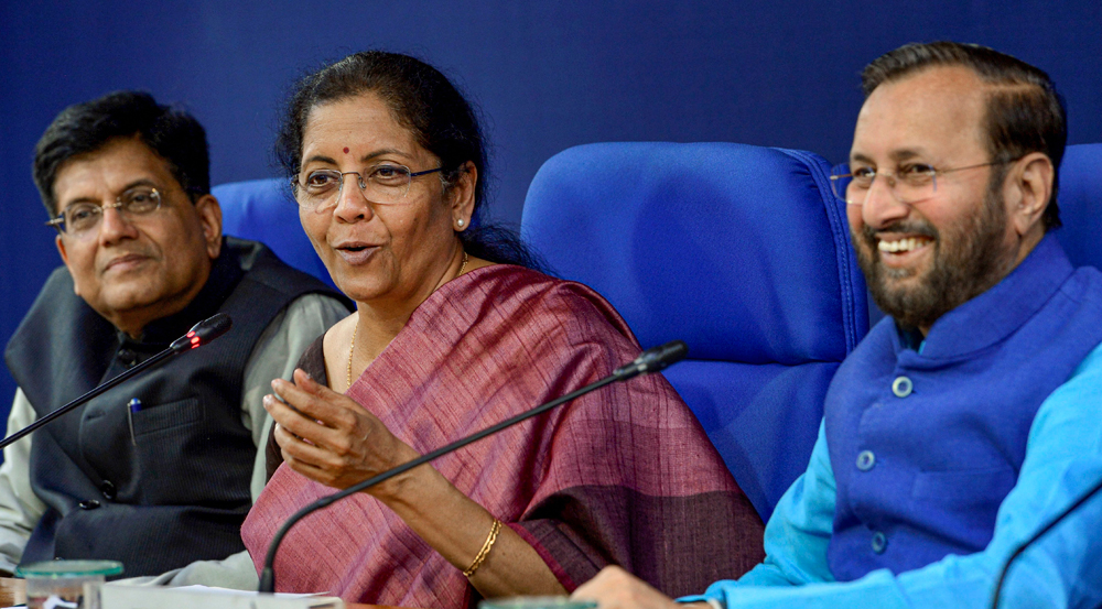 Finance Minister Nirmala Sitharaman addresses a press conference after the cabinet meeting, in New Delhi, Friday, March 13, 2020. Union Minister for Railways Piyush Goyal (L) and Union Minister for Environment Prakash Javadekar (R) are also present.