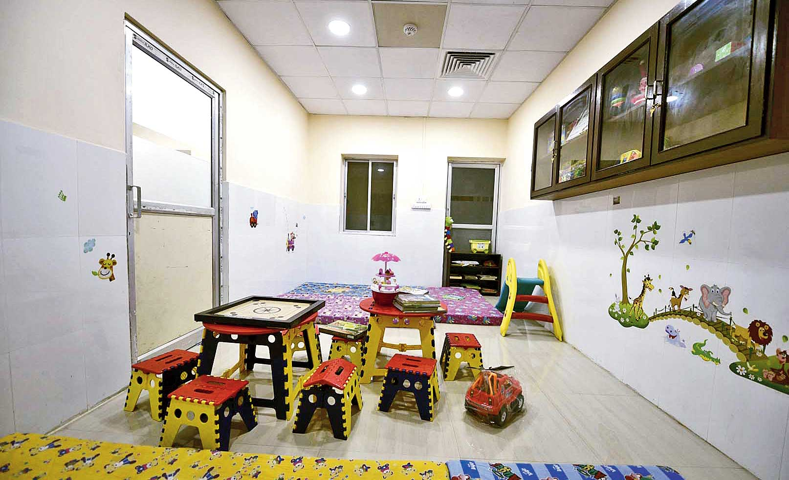 The playroom of the rehabilitation centre at the Institute of Child Health in Park Circus that has board games, building blocks, storybooks and a small slide.