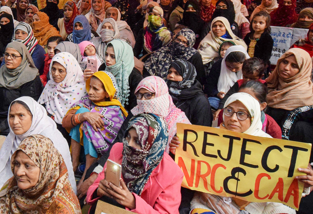 Women at a demonstration against the citizenship amendment and the National Register of Citizens in Allahabad on Tuesday. Of the 40 civilians shot at during previous protests, 19 died while five were still in hospital three weeks later on January 12
