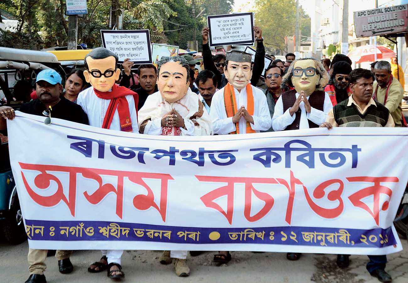 Protesters wear masks of Assam littérateurs in Nagaon on Saturday.