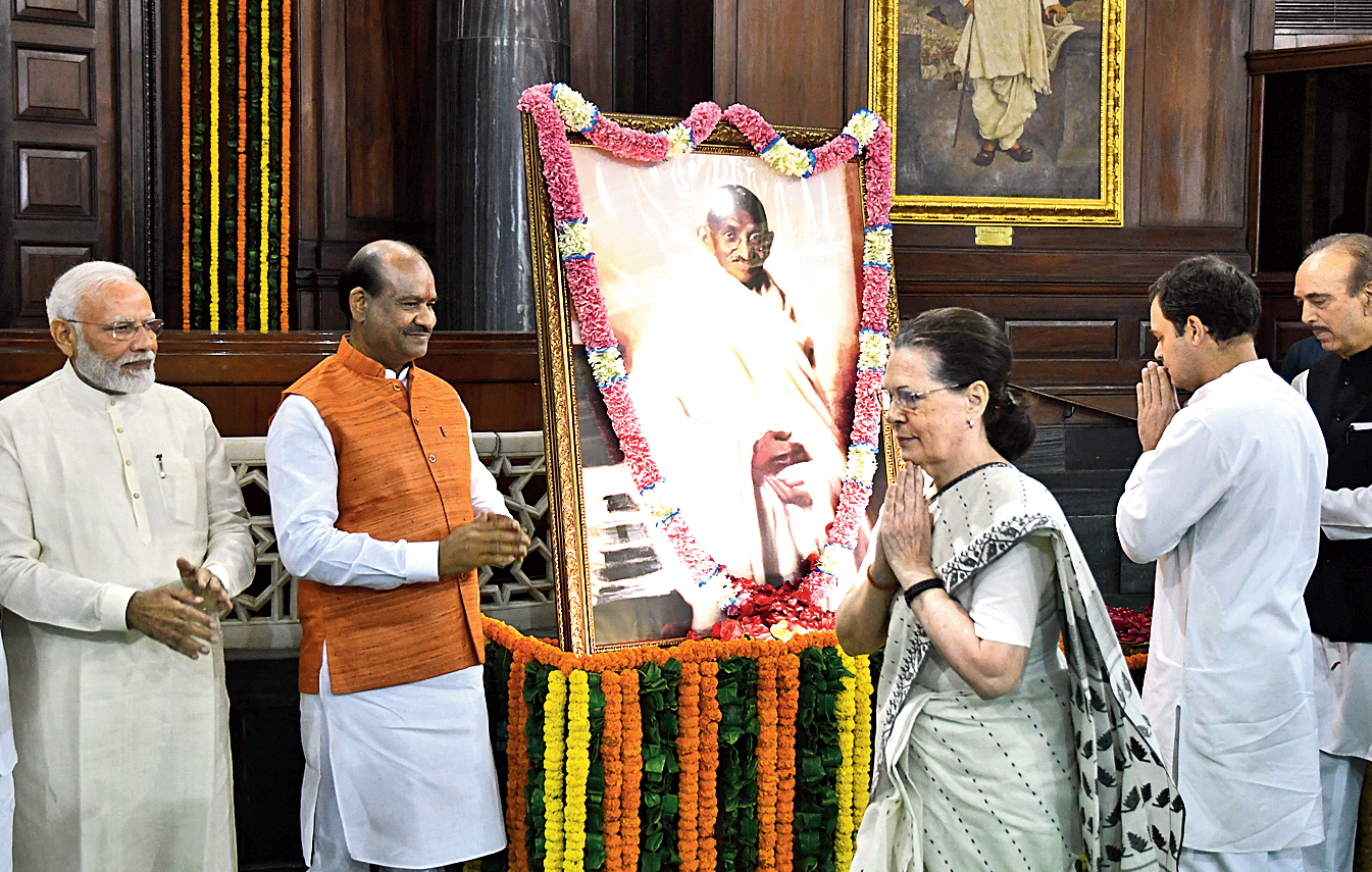 Narendra Modi, Sonia Gandhi and Rahul Gandhi pay tribute to Mahatma Gandhi in Parliament on Wednesday.