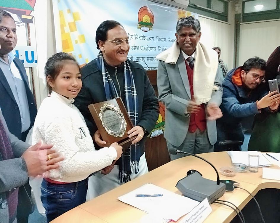 Union human resource development minister Ramesh Pokhriyal Nishank felicitates Meaidaibahun Majaw in Shillong for developing the anti-bullying app