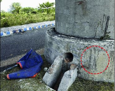 The pillar of the New Garia-Airport Metro corridor in New Town that was hit by a Honda City on Tuesday. According to engineers, the pillar did not suffer any damage because of a crash barrier (circled) at the base.