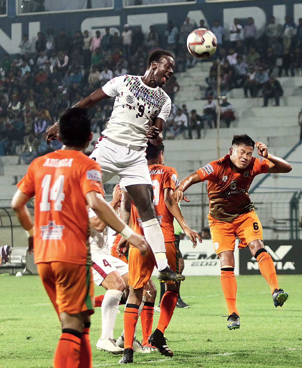 Mohun Bagan's Baba Diawara in an aerial tussle with Neroca FC players on Friday