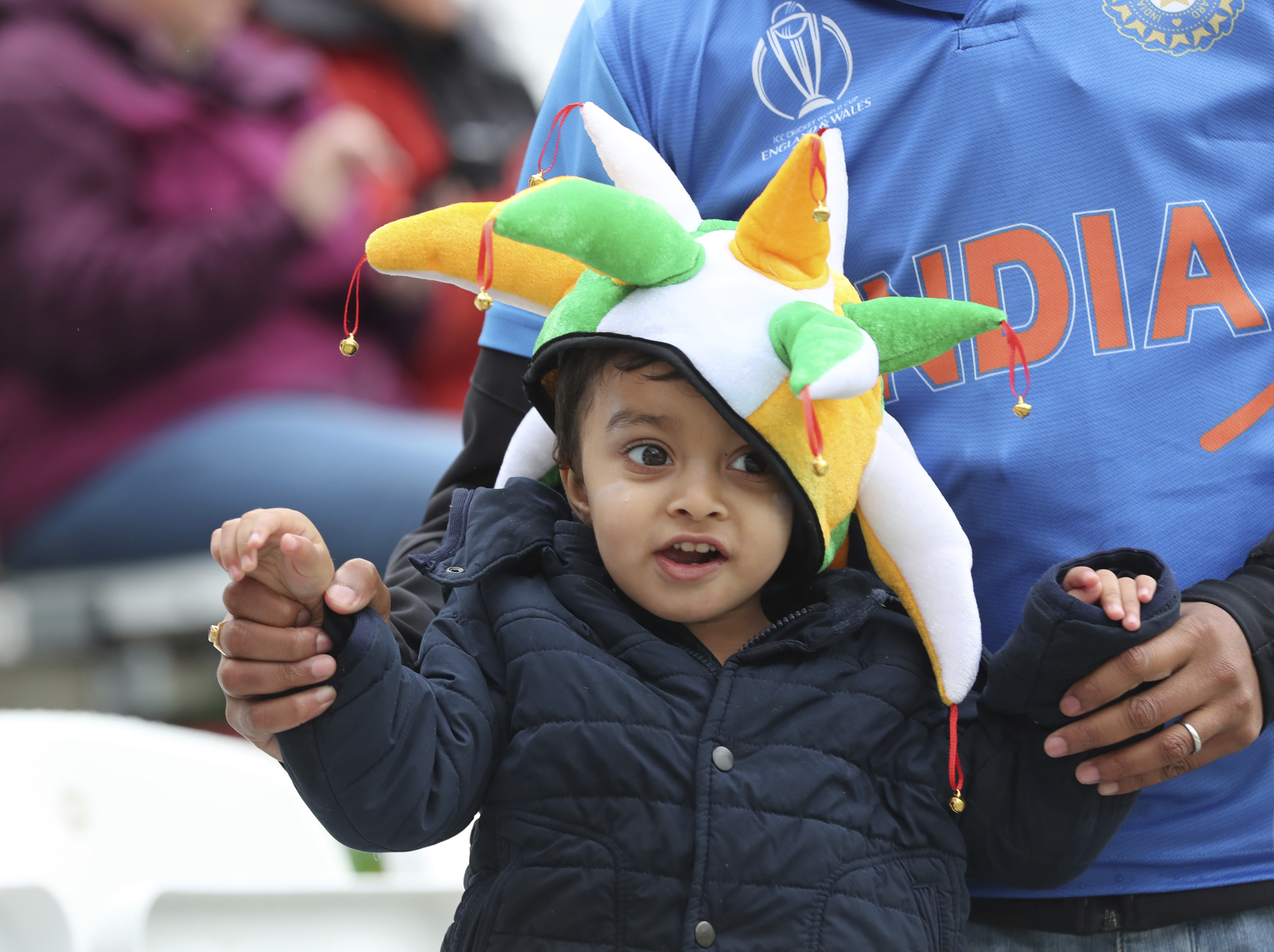 A young Indian fan at Trent Bridge waits for India and New Zealand to start playing at Trent Bridge in Nottingham on June 13. India and Pakistan will face off at Old Trafford.