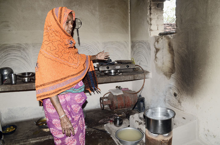 Budhni devi, a resident of Beganaria village, shows her unused LPG gas connection in Tundi, Dhanbad, on Monday.