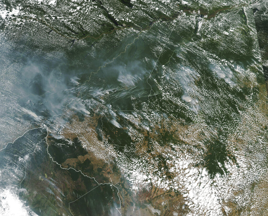This satellite image provided by NASA on Aug. 13, 2019 shows several fires burning in the Brazilian Amazon forest