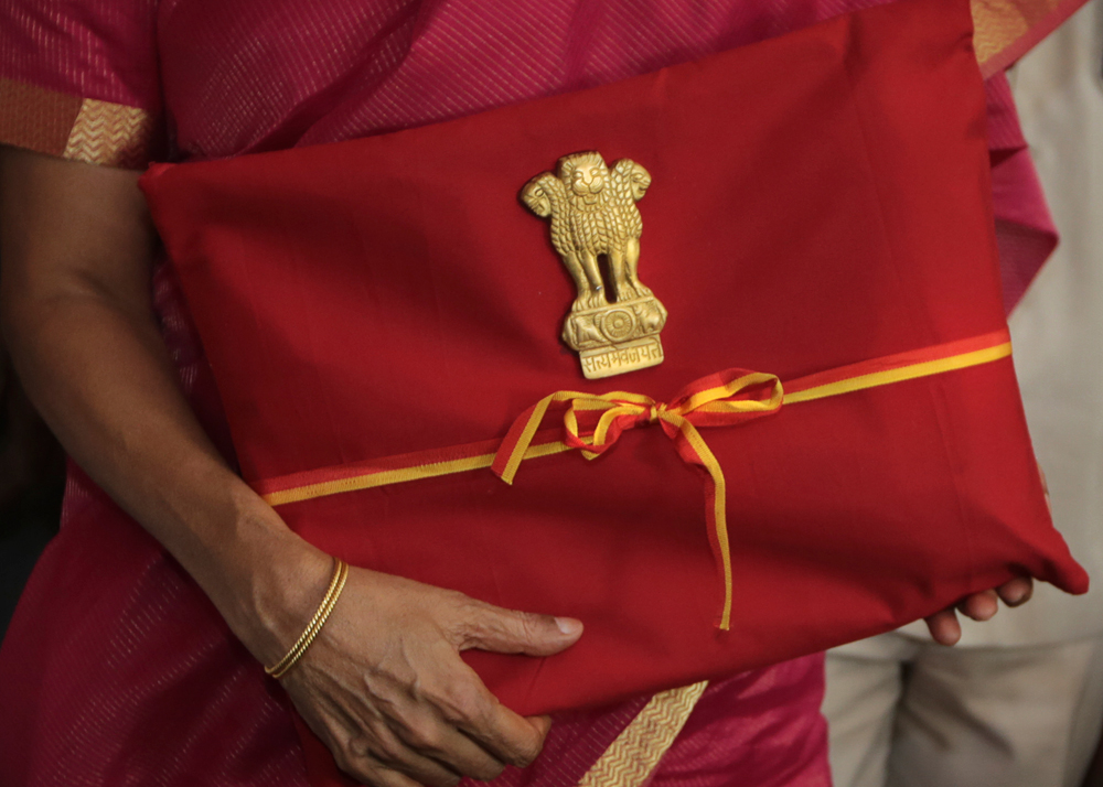 Nirmala Sitharaman carries the budget papers on way to Parliament on Friday. At best, the Union budget is a tweaked version of the interim budget.