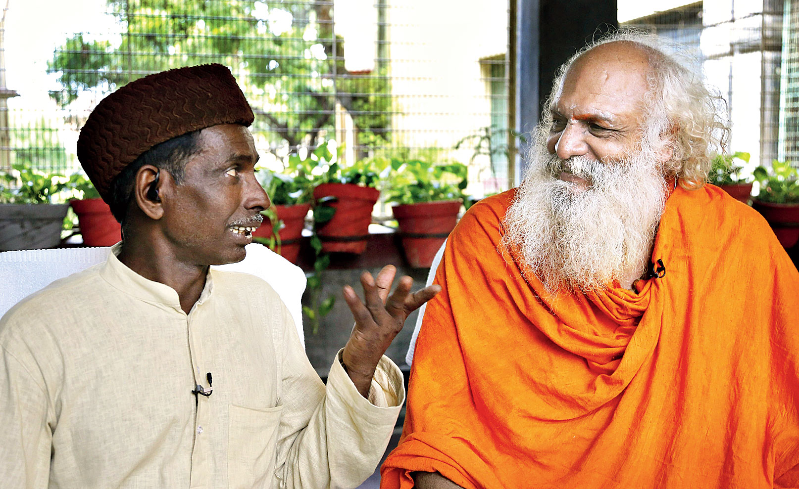 Iqbal Ansari and Nirmohi Akhara mahant Dharam Das, the main litigants in the case, after the ruling on Thursday.