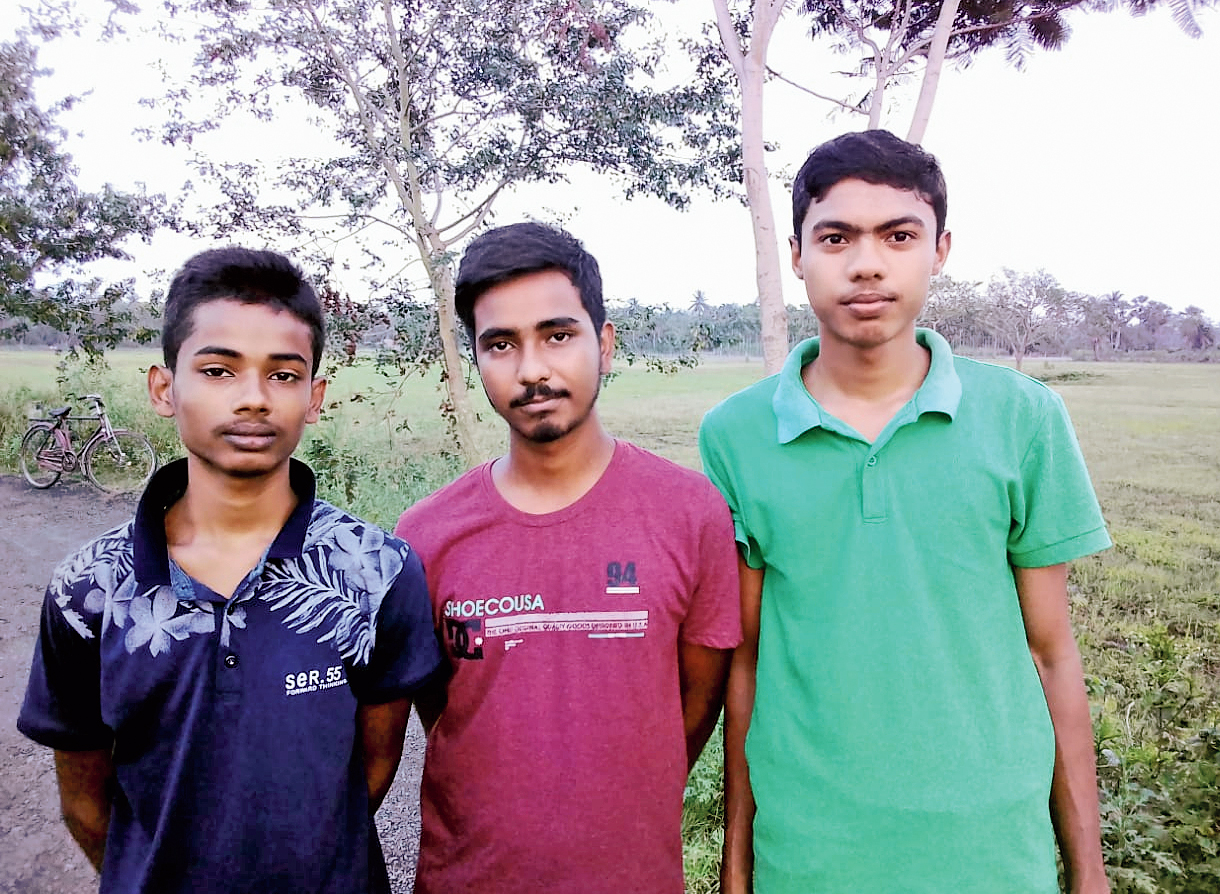 (From left) Subhajit Ghorai, Sagar Pal and Samiran Khara, all HS examinees who have been teaching children of their study centre during the lockdown