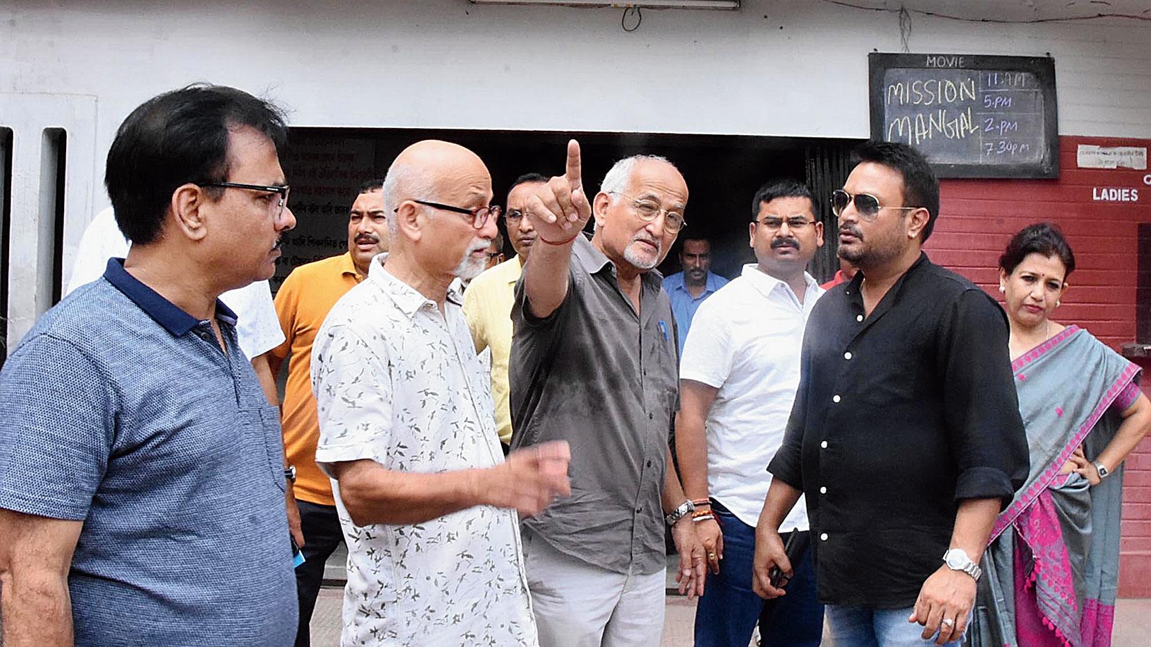 Jatin Bora interacts with the propieter of Jonaki cinema hall on Thursday.