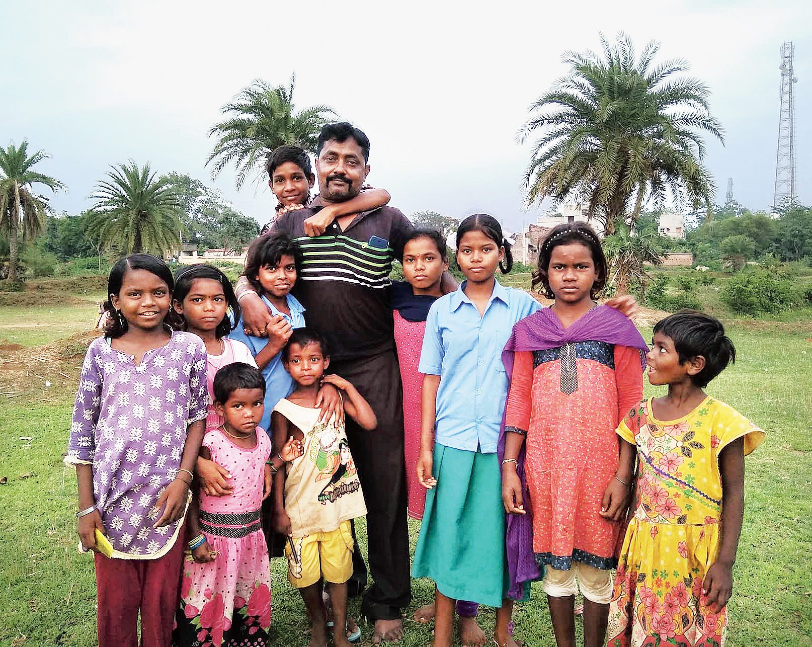 Arup Mukherjee, a constable of the South Traffic Guard, with some of the students of the school that he started with his savings in 2011 at Puncha village of Purulia district.