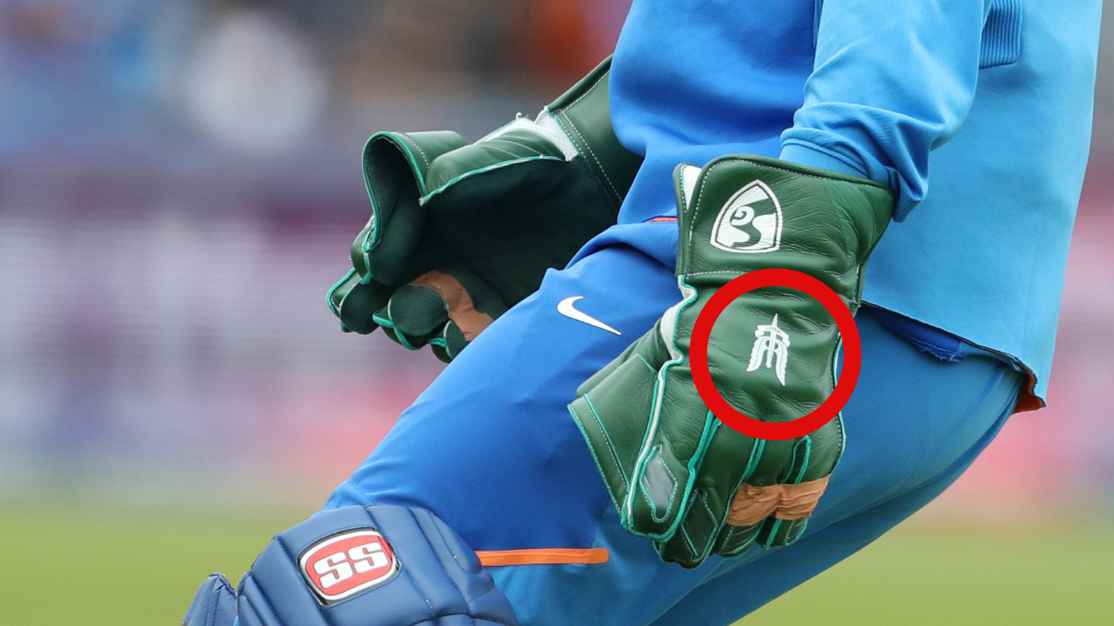 Dhoni's glove with the Para Special Forces insignia on it.