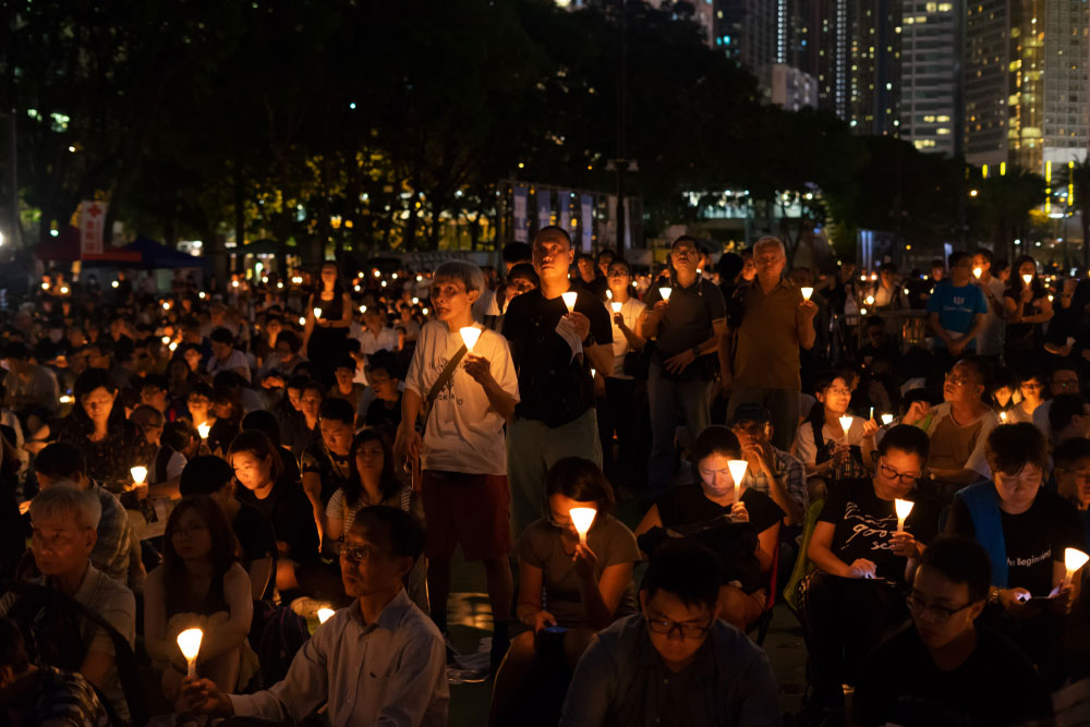 Tens of thousands at the candlelight vigil at Victoria Park, Hong Kong to mark the military crackdown on protests in China's Tiananmen Square in 1989.