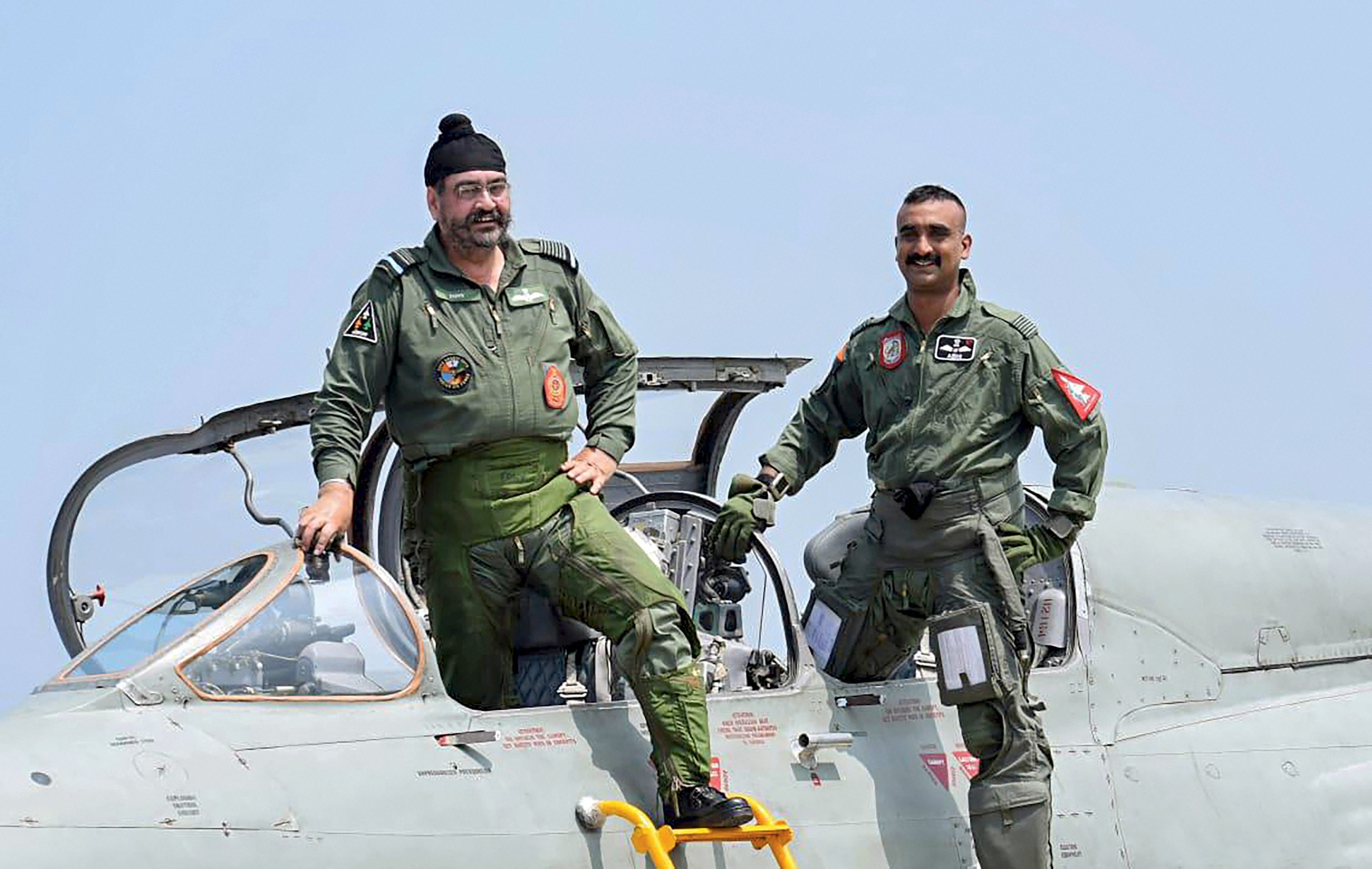 Pathankot: Air Chief Marshal BS Dhanoa and Wing Commander Abhinandan Varthaman, the IAF pilot who became the face of a tense military confrontation between India and Pakistan in February, pose for a photograph after a sortie on the MiG 21 jet, at Airforce Station, Pathankot, Monday, Sept 02, 2019.