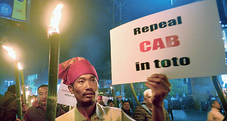 Protesters take out a torch-lit rally in Guwahati on Saturday