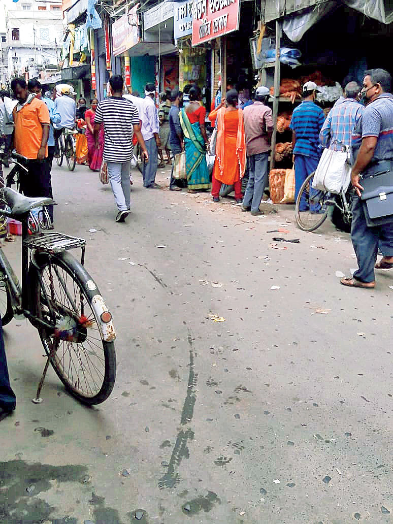 A queue in front of a hardware shop to buy asbestos sheets at Kakdwip