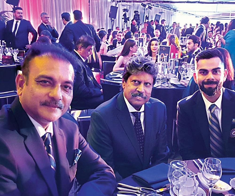 Ravi Shastri, Kapil Dev and Virat Kohli during an awards function in London