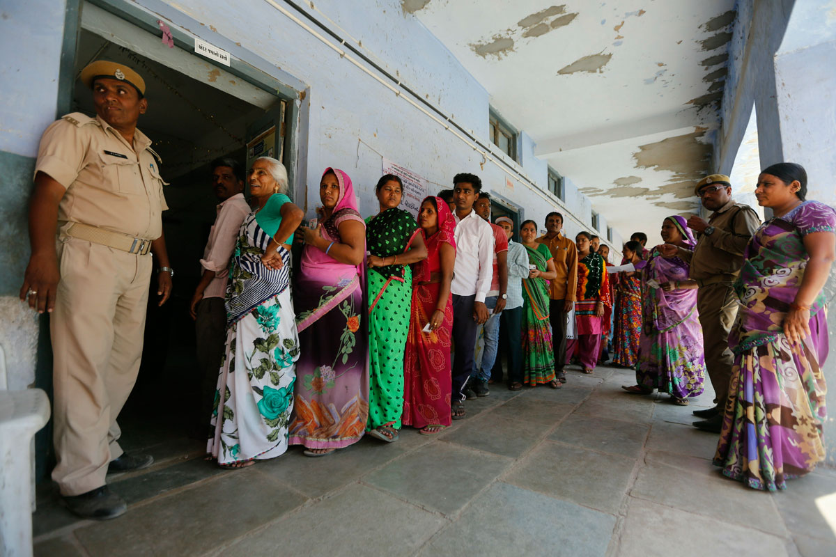 People stand in a queue to cast their vote on Tuesday, April 23, 2019