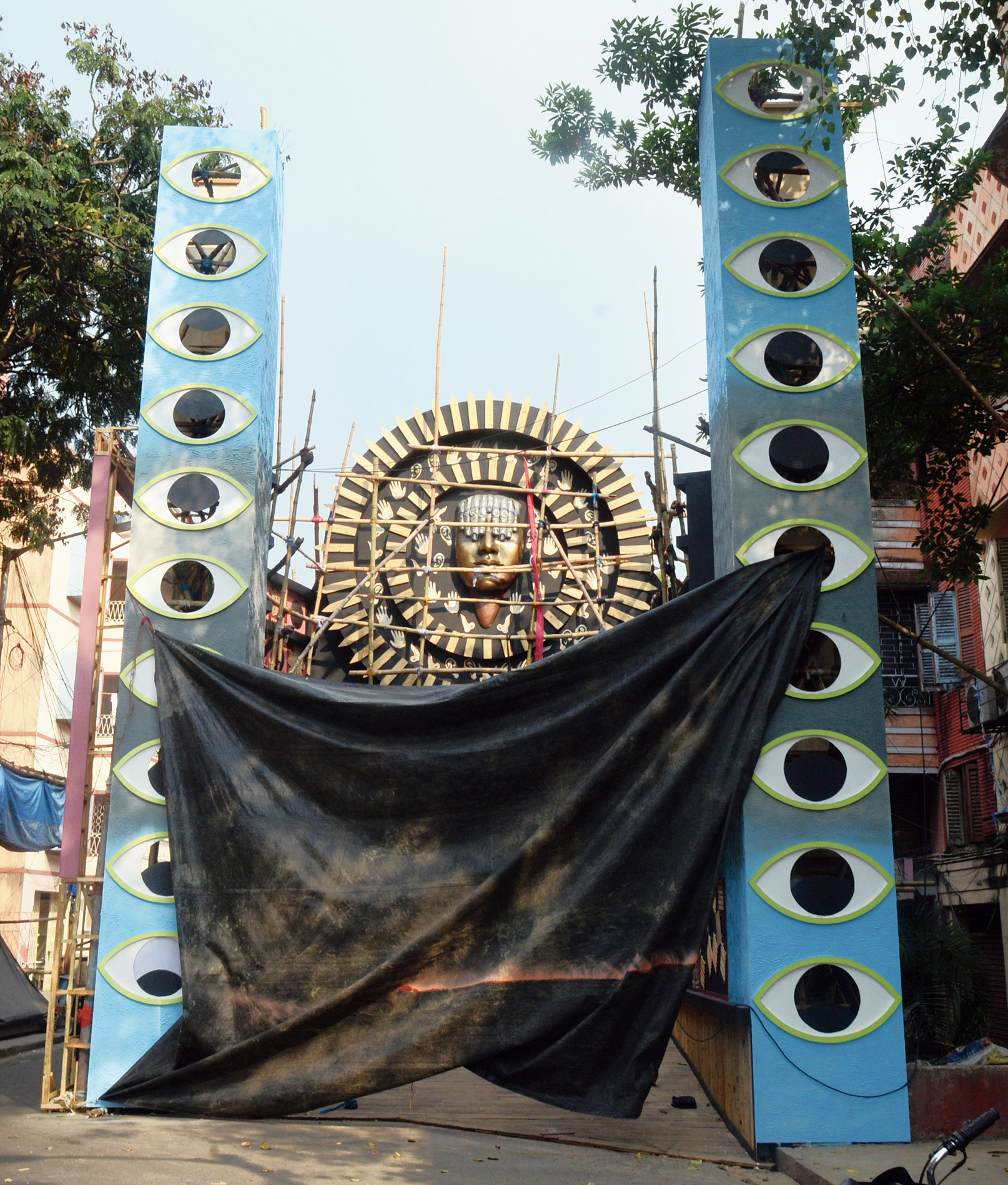 An artwork atop the pandal that suggests that the hands of a visually impaired person are his/her eyes.