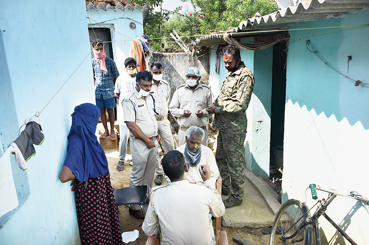 The police investigate the twin murders at Jaganathpur in Ranchi on Sunday.