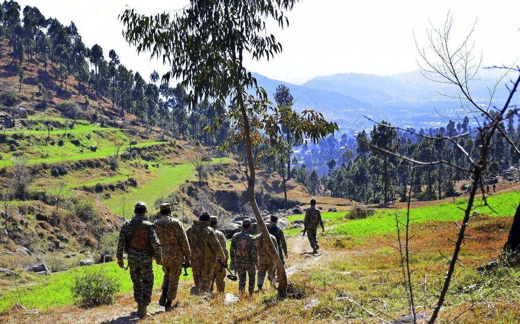 Pakistani soldiers patrol in the area where Indian planes launched a pre-dawn airstrike on Tuesday near Balakot in Pakistan.