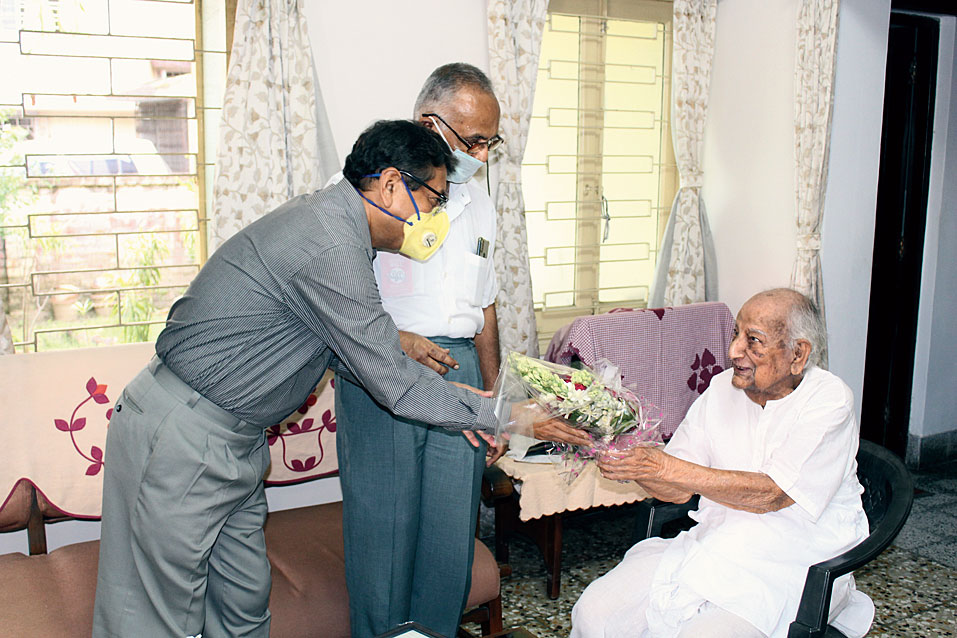 Mihir Kumar Chatterjee receives a bouquet from well-wishers on his birthday at his EC Block house last Friday