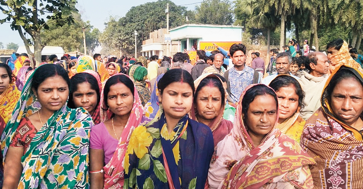 Women protest against an NGO worker at Gourbazar in Birbhum on Wednesday.
