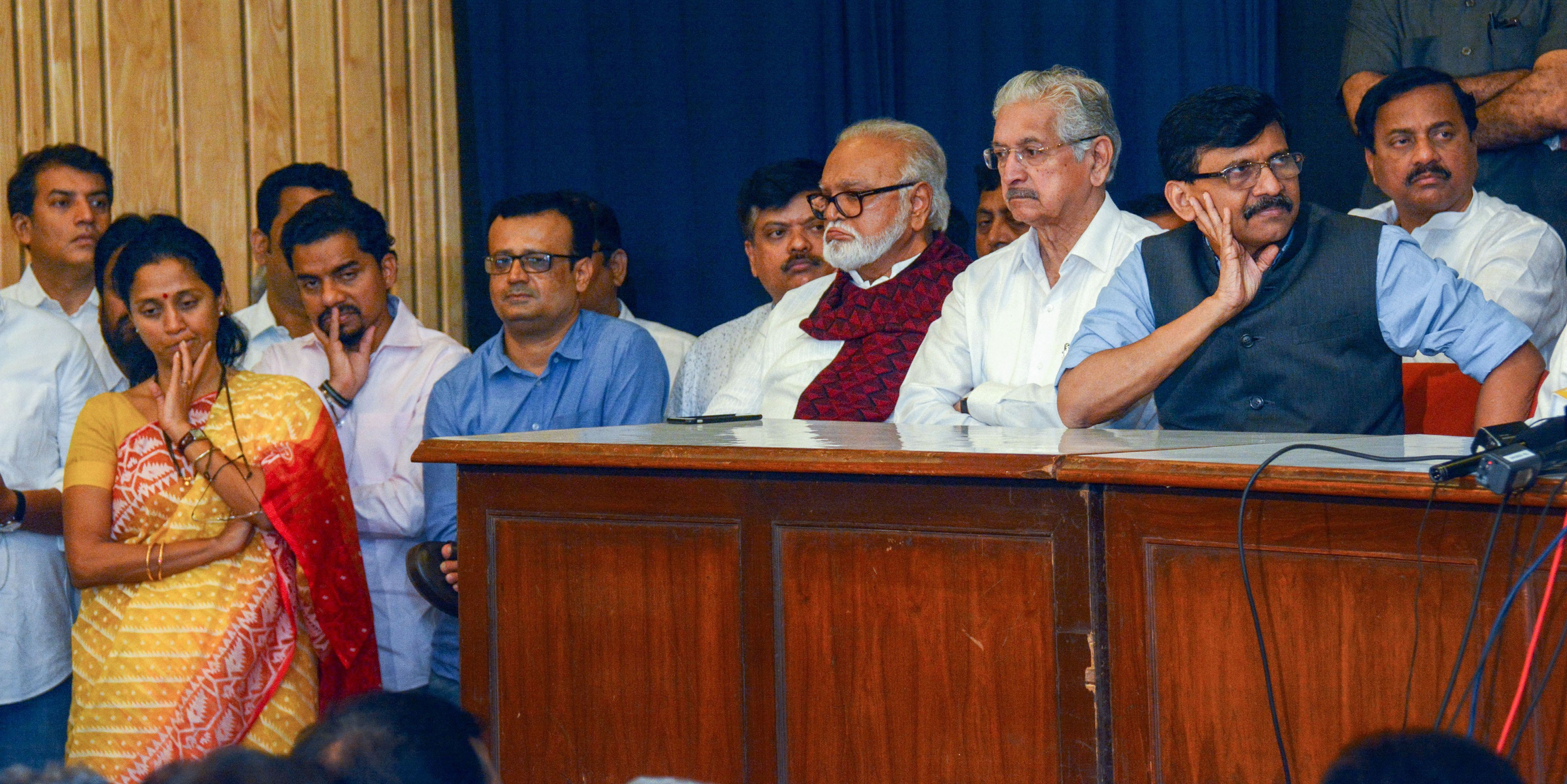 NCP's Supriya Sule, Sunil Tatkare and Chhagan Bhujbal with Sena leader Subhash Desai and Sanjay Raut during a joint press conference, in Mumbai, Saturday, Nov. 23, 2019.