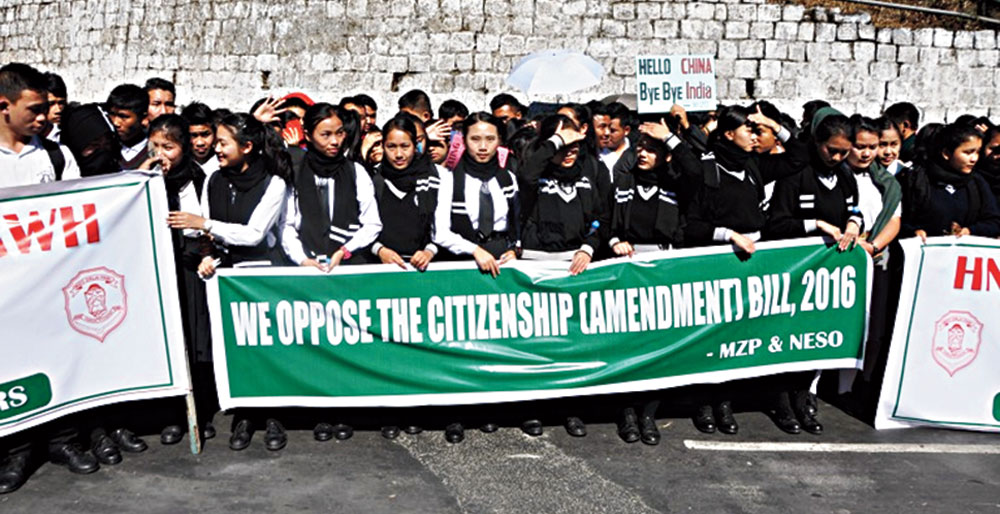 Students hold placards during the protest in Aizawl