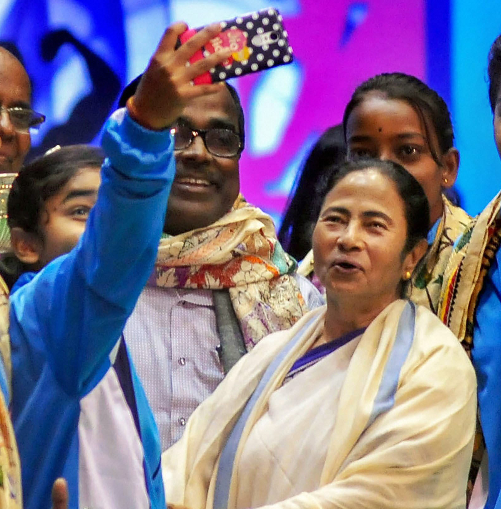 Women's junior volleyball national champion team takes a selfie with West Bengal Chief Minister Mamata Banerjee where they were awarded a special award at 'Khelashree' in Calcutta on Monday, Jan. 28, 2019.