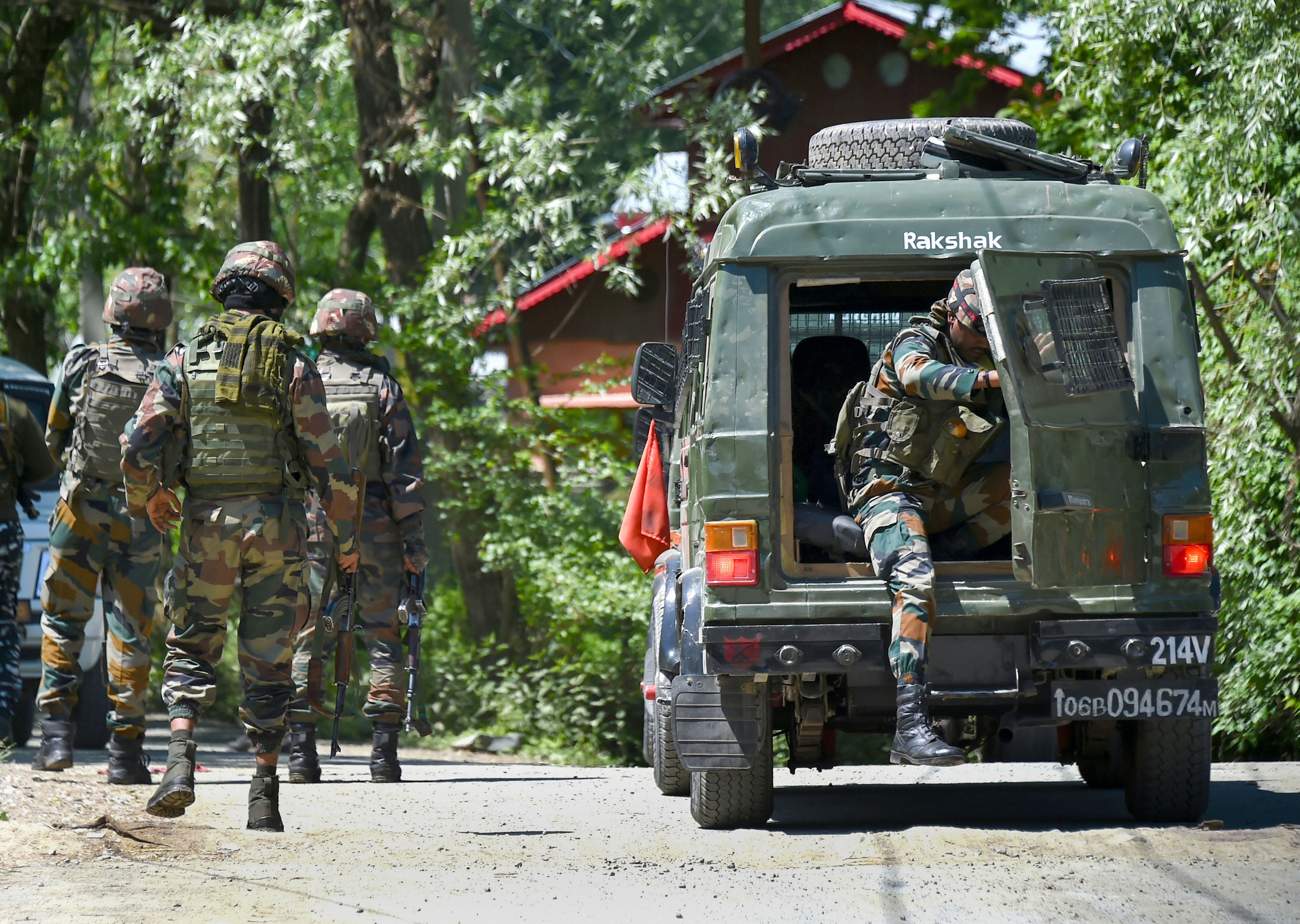 Indian Army soldiers arriving at the encounter site at Beighpora area in Pulwama district of South Kashmir, Wednesday, May 6, 2020