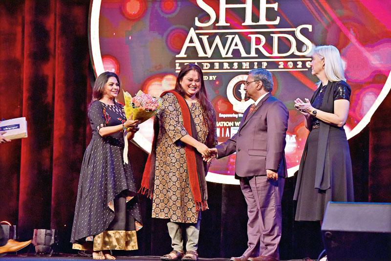 Sohini Sengupta receives her award from Sudipta Chakraborty, US consul general Patti Hoffman and K.K. Chatterjee, manager Mrignayani Sarees.