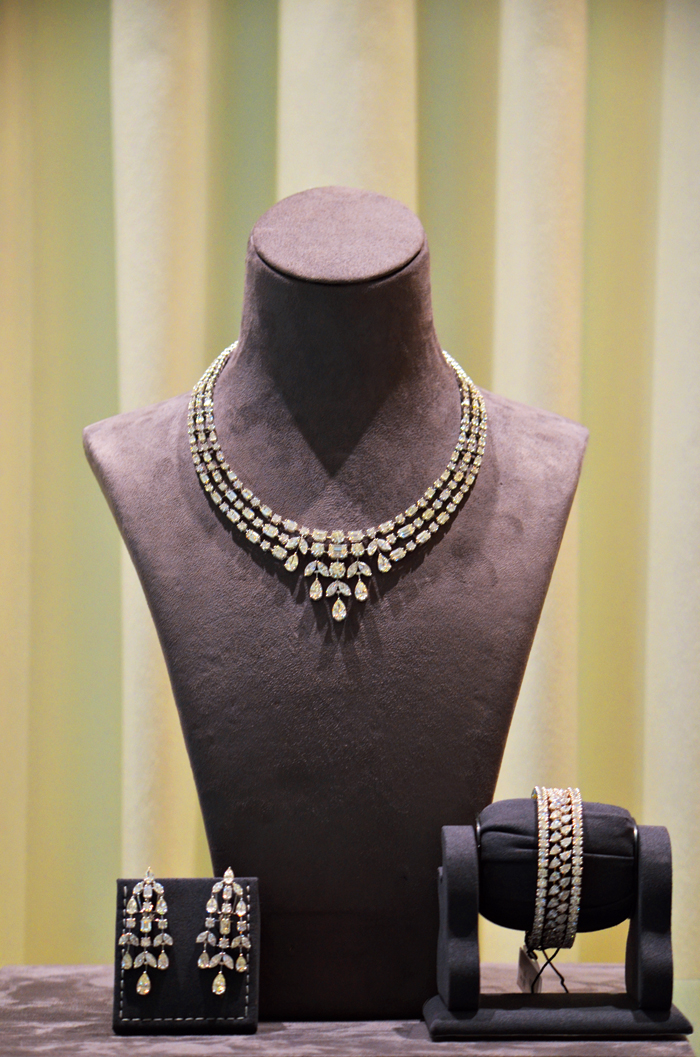Accessorise your gown with this 18-carat gold necklace set studded with diamonds, at the engagement party. Paired with the earrings and bangles, this is a sure head-turner.  Rs 1,25,00,000 @Nemichand Bamalwa and Sons (J)