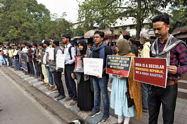 A human chain at Rabindra Sadan on Wednesday to condemn the violence in Delhi. Noor Mahvish, a law student (fourth from right), lost family members in Partition riots, at the protest.