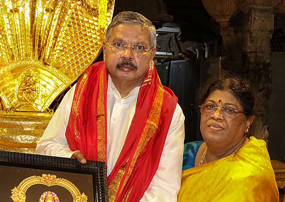 NHRC chairman Justice H.L. Dattu and his wife being offered a holy memento at Lord Venkateswara temple, at Tirupati in Chittoor district on Sunday, June 09, 2019.