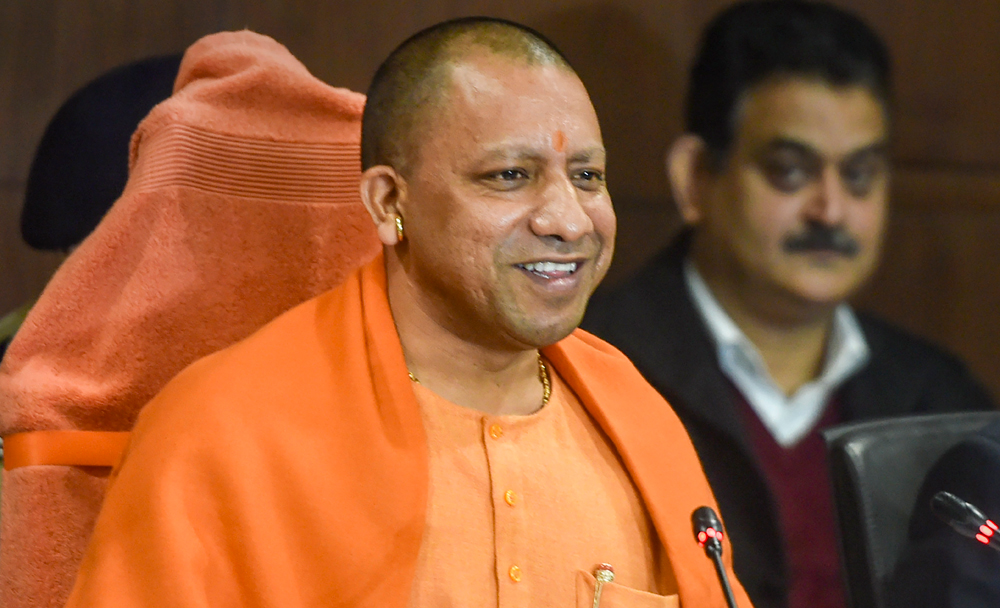 Yogi Adityanath at a news conference in Lucknow on Monday