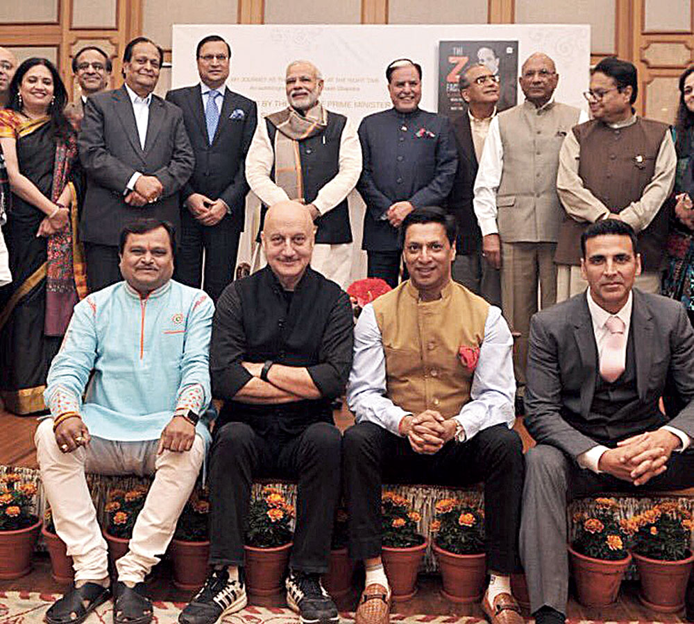 CRONY CAST: Modi strikes a Hum Aapke Hain Kaun-like pose with a few of his cinema favourites