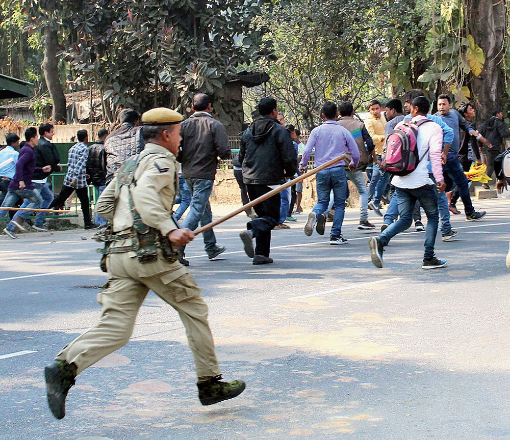 Police lathicharge protesters in Guwahati on Wednesday.