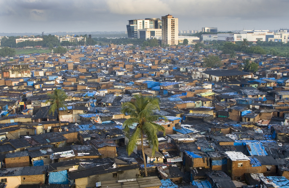 Contrast of modern highrise buildings and slums at Prem Nagar Goregaon Mumbai , Maharashtra.